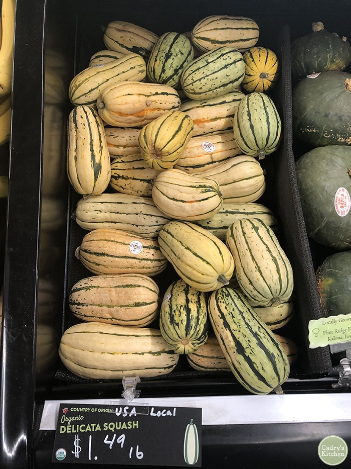 Delicata squash at grocery store.