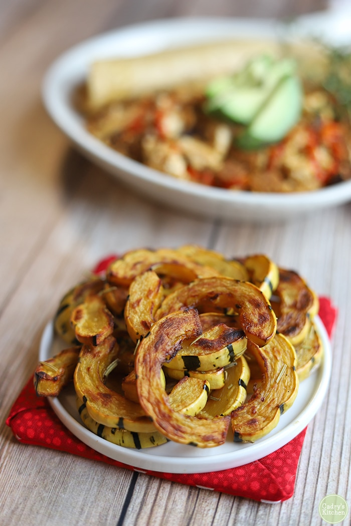 Roasted delicata squash on plate.