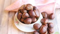 Chestnuts piled in a bowl.
