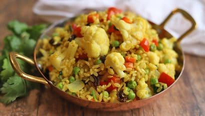 Ginger and turmeric rice in pan with vegetables.