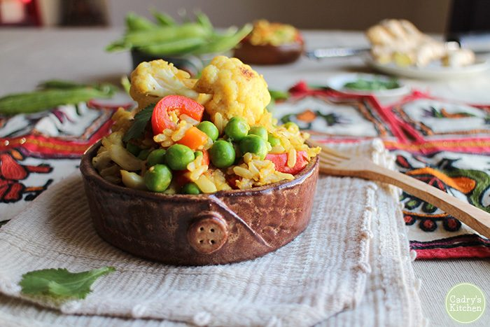 Vegetable fried rice with cauliflower, peas, and bell pepper in small bowl.