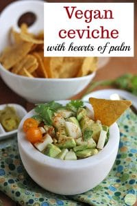 Text: Vegan ceviche with hearts of palm. Bowl of hearts of palm with tomatoes & avocado.
