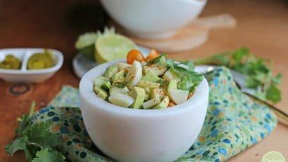 Vegan ceviche in white bowl on green napkin.