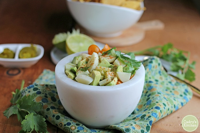 Vegan ceviche in white bowl on green napkin.