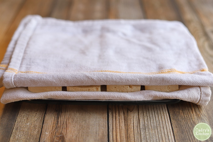 Tofu wrapped in towel.