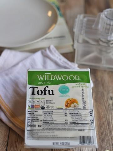 Wildwood tofu in package by towel & plate.