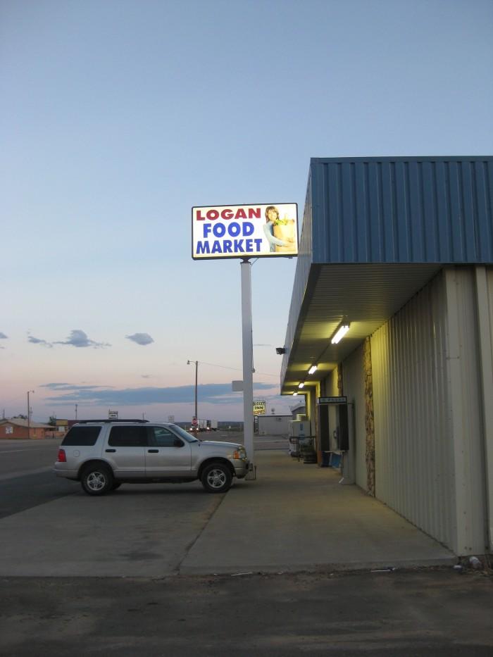 Exterior Logan Food Market on deserted road.