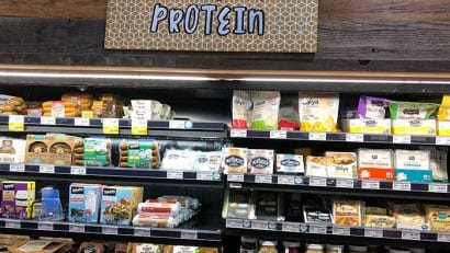 Grocery store display with plant-based protein options.