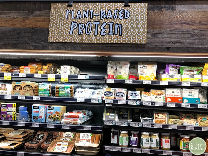 Grocery store display with plant-based protein options. Vegan snack ideas.