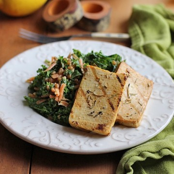 Grilled tofu slabs on plate with kale salad.