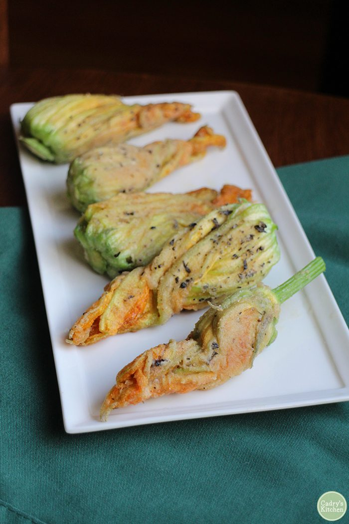 Fried cashew cheese stuffed squash blossoms. A decadent, vegan appetizer. Sure to impress! | cadryskitchen.com