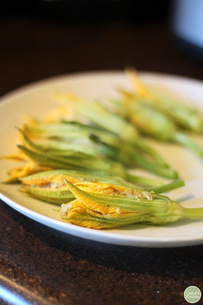Squash blossoms filled with vegan cashew cheese.