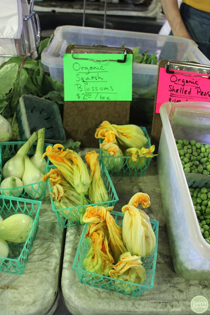 Organic squash blossoms at the farmers market.