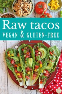 Text: Raw tacos. Vegan & gluten-free. Platter of raw tacos with vegetables and walnut taco meat.