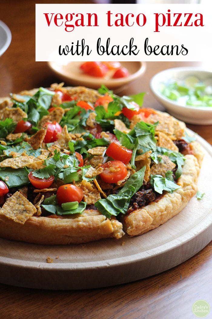 Vegan black bean taco pizza is delightfully flavorful & easy. Perfect for a weeknight. Plus, it's a dinner the whole family will love. #pizza #dairyfree #taco #vegan #vegetarian #beans #recipe #easy #weeknight