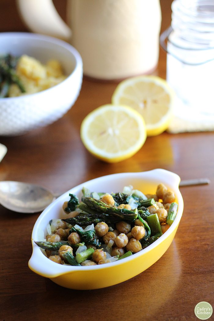 Nothing says spring quite like this roasted asparagus recipe. Filled with chickpeas and spinach, it's lovely over polenta, brown rice, or farro. Vegan. | cadryskitchen.com