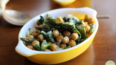 Roasted chickpeas and asparagus over polenta in Pyrex casserole dish.