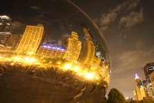 Downtown Chicago buildings reflecting in Cloud Gate.