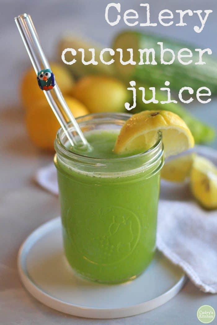 Text: Celery cucumber juice. Glass of cucumber celery juice with wedge of lemon.