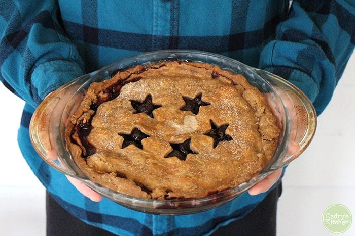 David holding fruit pie with star cut outs.
