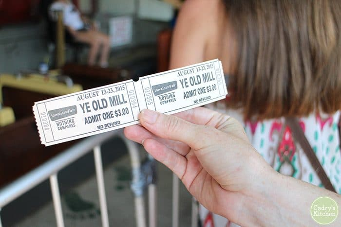 Hand holding Ye Old Mill ticket at Iowa State Fair.