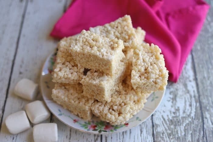 Platter of vegan rice krispie treats by marshmallows.