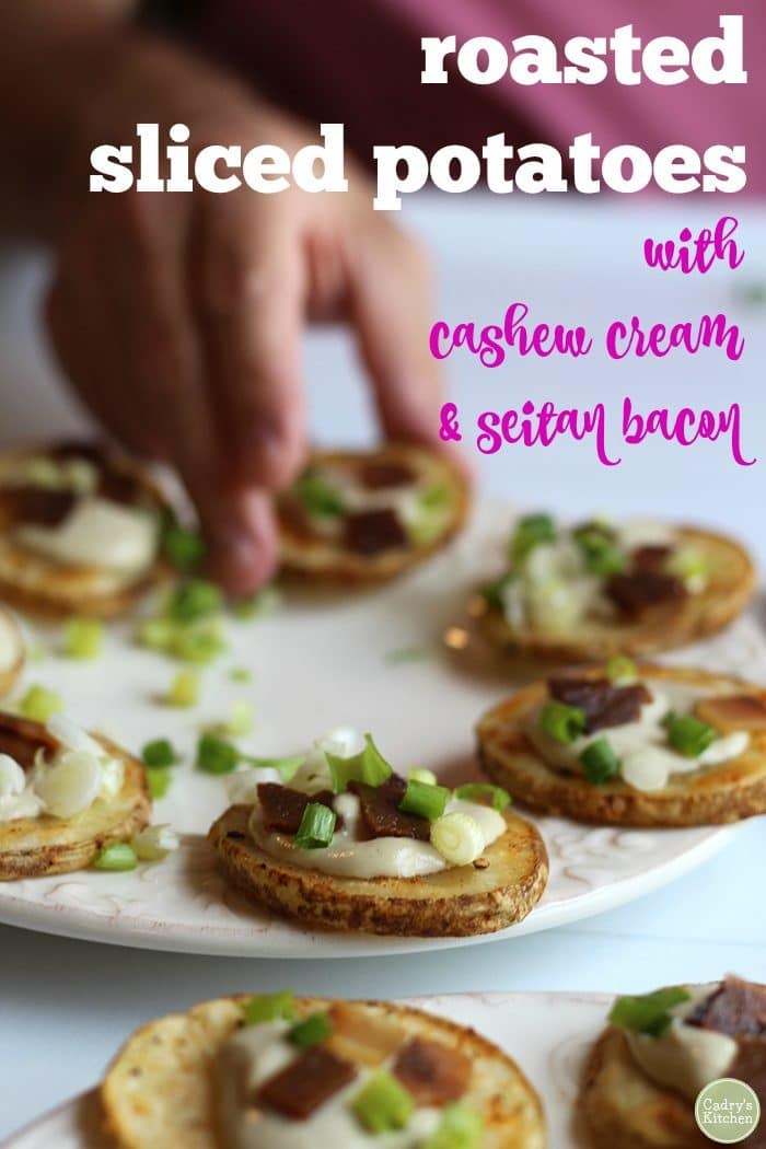 Roasted sliced potatoes with cashew cream & seitan bacon on platter + text.