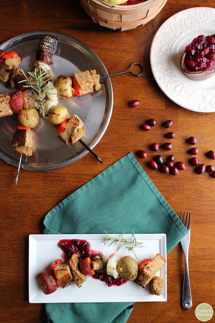 Venture outside your boring vegan Thanksgiving dinner with these grilled Thanksgiving kebabs. This vegan entree has all of your Thanksgiving favorites in deconstructed form. Potatoes, stuffing, seitan, and even sweet potatoes with marshmallows. Vegan. | cadryskitchen.com