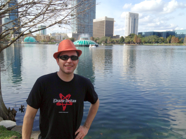 David stands in front of fountain at Lake Eola.