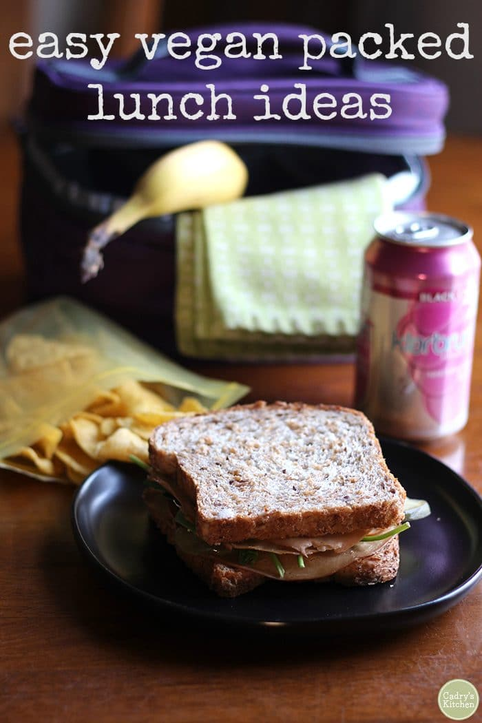 Text overlay: easy vegan packed lunch ideas. Sandwich, chips, banana, and Klarbrum sparkling water.