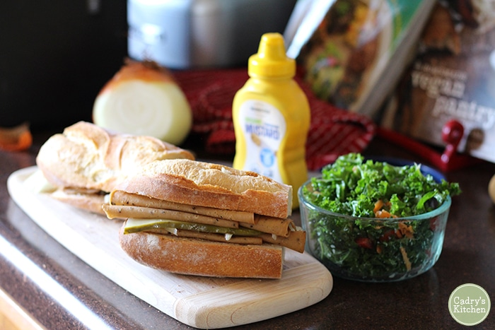 Vegan sandwich with mustard and salad.