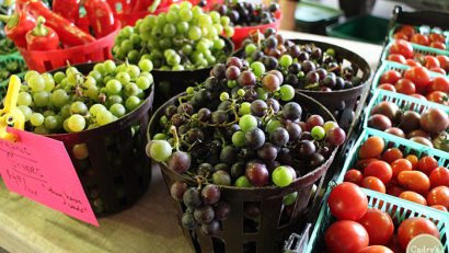 Grapes and tomatoes at farmers market.