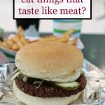 """Zombie Burger on metal paper with french fries. Plus text, """"Why do vegans eat things that taste like meat?"""""""