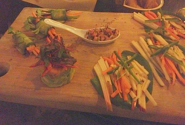 Raw zucchini roll ups on cutting board.