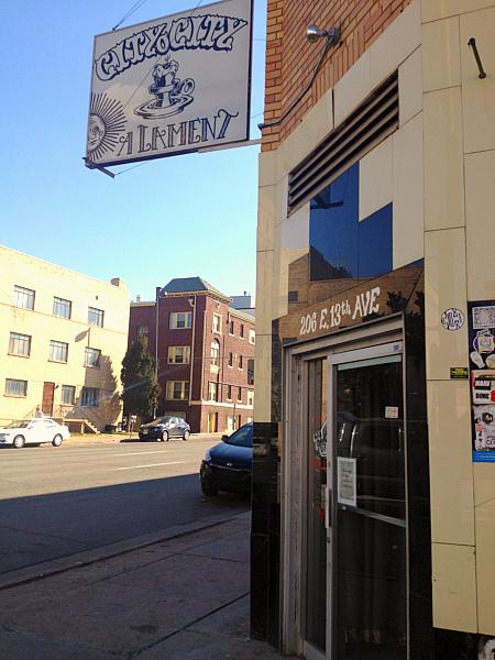 Exterior City O' City door and sidewalk.