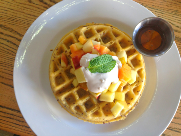 Power waffle with syrup on plate.