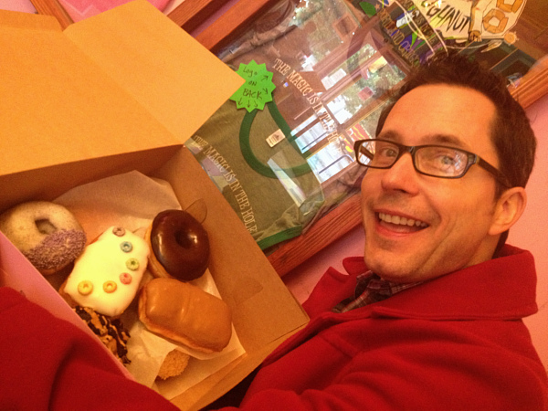 David holding box of donuts.