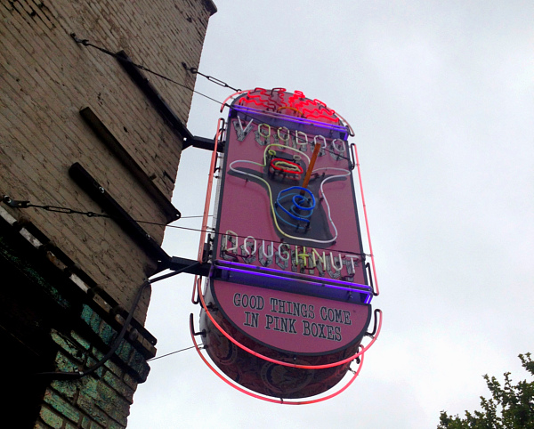 Neon Voodoo Doughnut sign in Portland.
