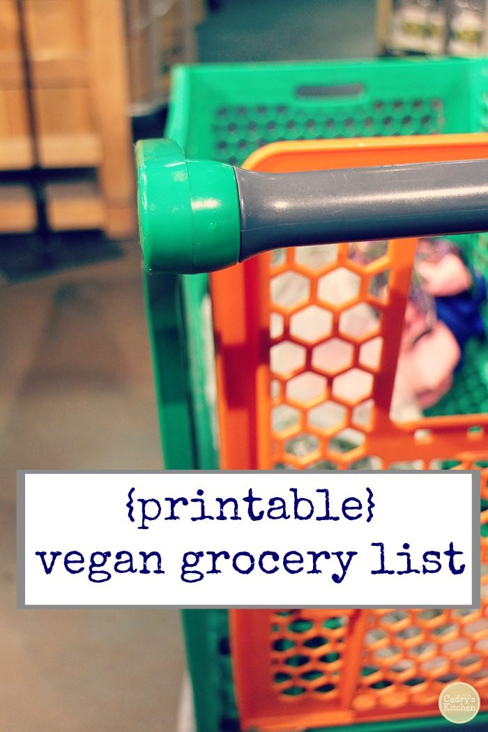 Text overlay: Printable vegan grocery list. Orange and green cart at grocery store.