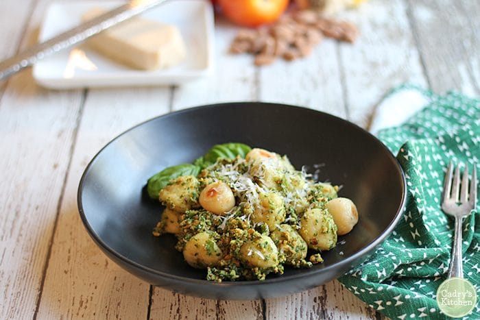 Roasted gnocchi with vegan almond pesto in bowl.