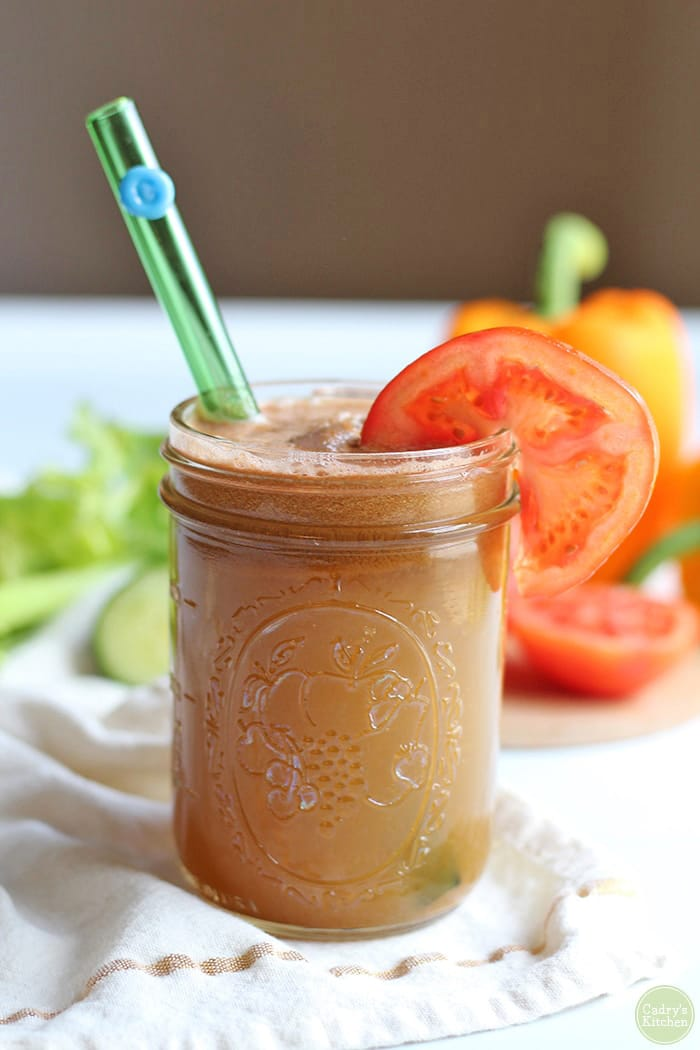 Vegetable juice recipe in glass with straw.