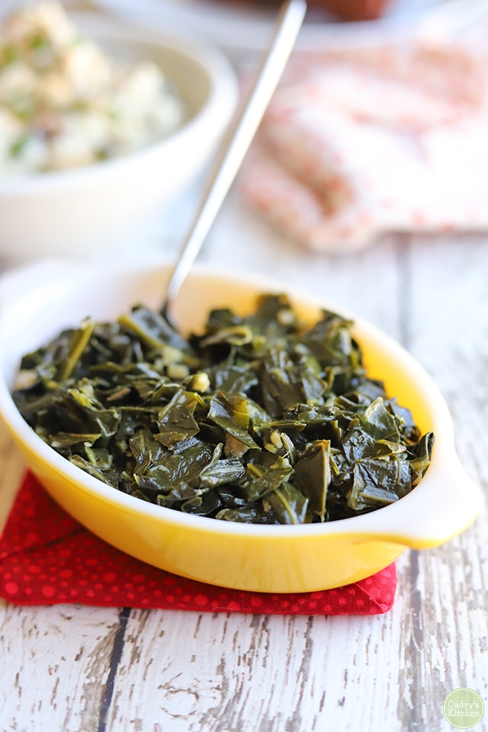 Easy collard greens in a yellow Pyrex dish.