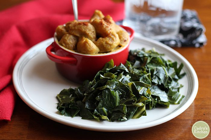 Garlicky vegan collard greens are slow cooked and tender. They make for a mouthwatering and nutrient-dense side dish. | cadryskitchen.com