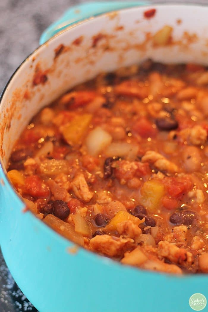 Meatless chili in pot with Soy Curls, beans, and fire roasted tomatoes.