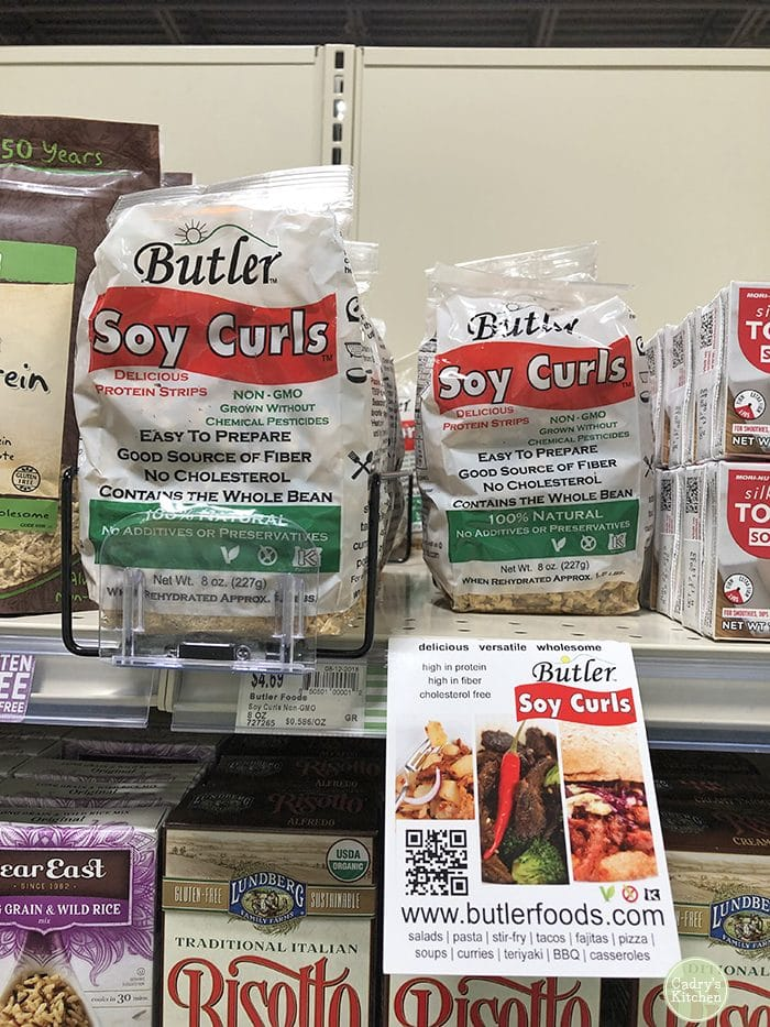 Packages of Soy Curls on grocery store shelf.