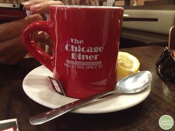 The Chicago Diner mug with lemon and spoon.