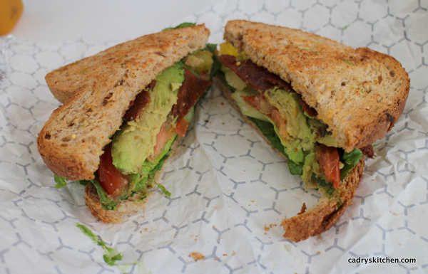 BLT with avocado on foil paper.
