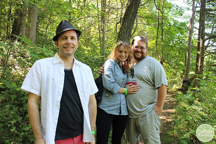 David, Ashley, and Adam standing on trail by trees.