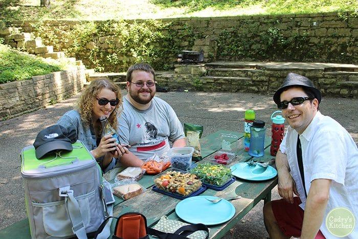Ashley, Adam, and David at picnic table in Maquoketa, Iowa.