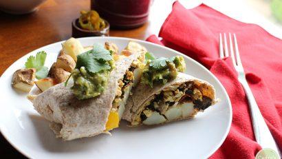 Breakfast burritos stuffed with tofu scramble, roasted potatoes, and veggie bacon. A comforting vegan breakfast! | cadryskitchen.com